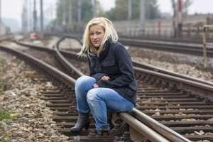 a young woman is sad, anxious and depressed. sitting on a track